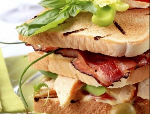 Toasted bread with grilled turkey meat and bacon