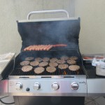 Hamburgers and hot dogs on the grill, they'll be ready soon!