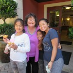 Anne gives big hugs to our bake sale volunteer's (left to right) Jasmine, Sherilynn and Franzine.