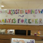 Happy National Assisted Living Week sign painted by the residents.