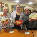 Dale, Sonia, and Carla show off their bowls of salad.