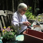 Mary is carefully adding the soil to the planter. Next she will place the flowers she picked out in the planter to make the first spring flowers planted in the garden. Thank you Mary.