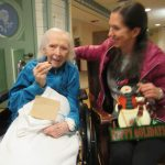 Delores and daughter join in on the tree decorating fun.